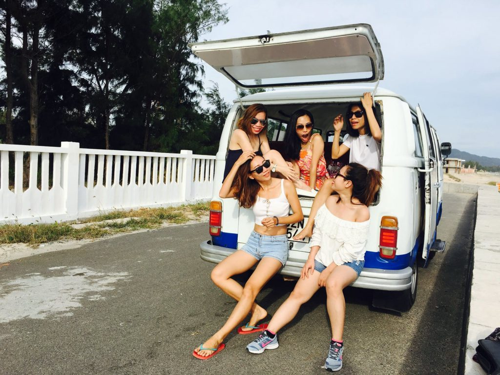 Women sitting in back of a van